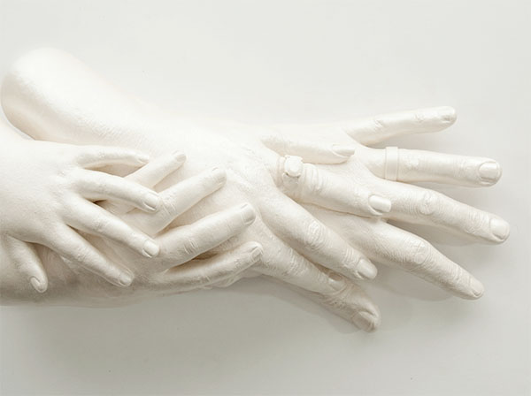 Opal Family Sculpture of four hands piled atop each other